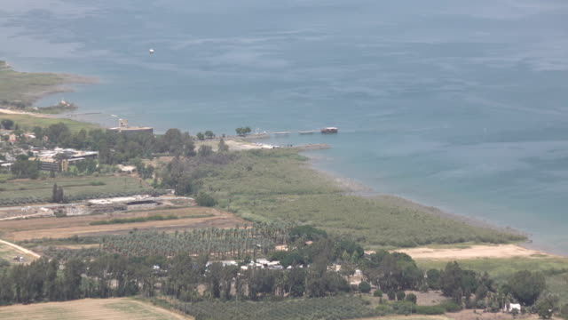 Slow Pan Up Coast of Sea of Galilee from Top of Mountain video