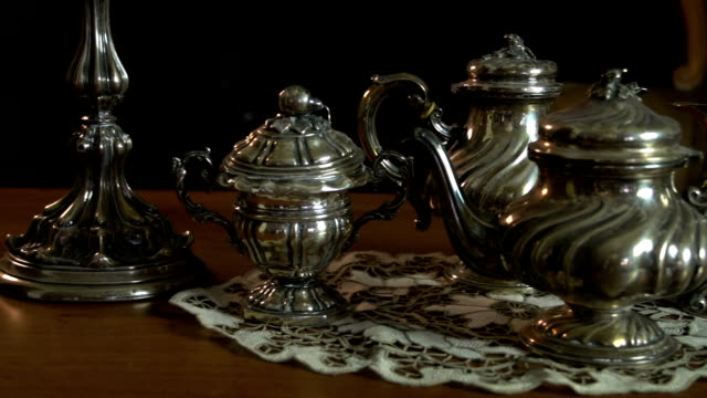 slow panning on vintage silverware teapot milk pan and candle holder fdv - teapot stock videos & royalty-free footage