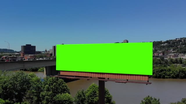 Slow Push Forward Aerial View of City Green Screen Billboard