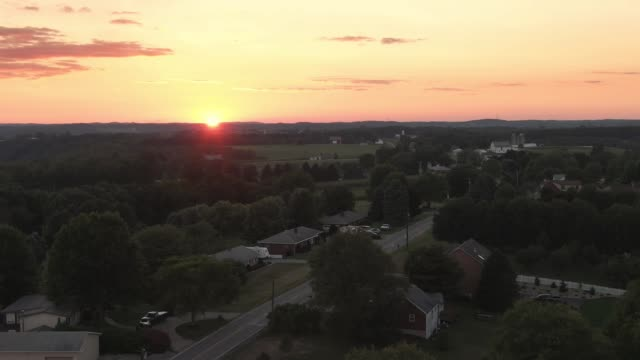 slow reverse aerial establishing shot of pennsylvania sunset - dusk stock videos & royalty-free footage