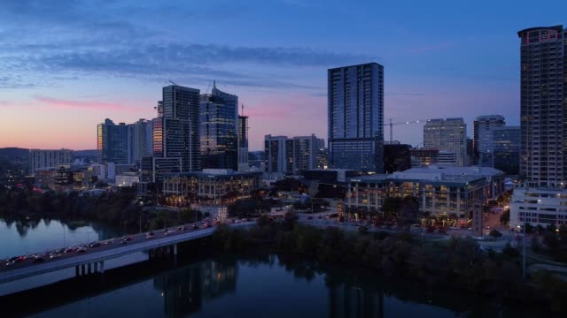 Slow Reverse Aerial View of Austin City Skyline at Dusk video