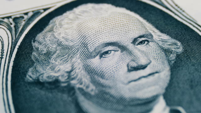 Slow Rotating George Washington Portrait on One Dollar Bill
