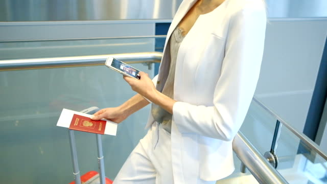 Slow shooting of woman taking photos of passport on phone video