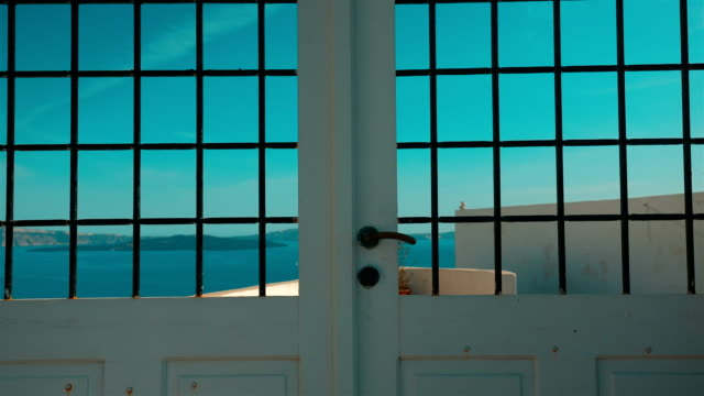 Slow Tilting Shot of a Typical Cycladic Mediterranean Door with a View to the Sea video