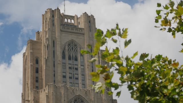 slow tracking dolly shot of top of cathedral of learning - cathedrals stock videos & royalty-free footage