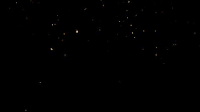 stockvideo's en b-roll-footage met langzaam vallende ronde gevormde gouden pailletten op een zwarte achtergrond hd - meerdere lagen effect