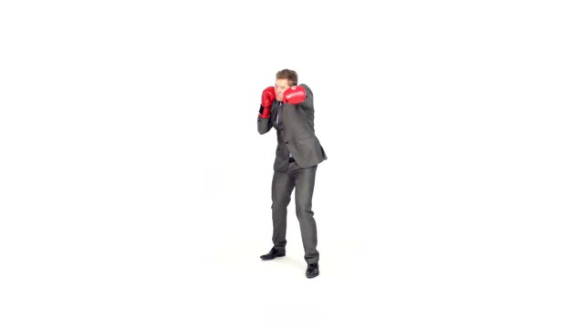 Slow-Mo: Businessman With Boxing Gloves Punches And Expresses Success video