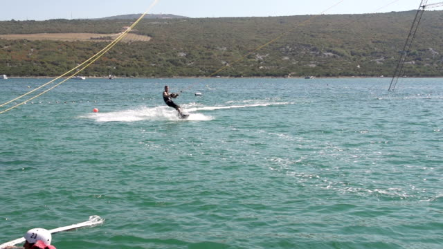Slow-Mo: Confident Wakeboarder Looking At Camera While Jumping video