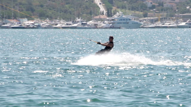 Slow-Mo: Extreme Wakeboarder Carving Fast video