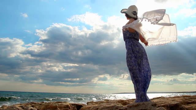 Slow-mo of beautiful feminine brunette enjoying liberty, looking at seascape video