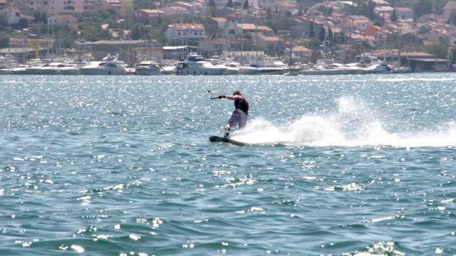 Slow-Mo: Strong Wakeboarder One Handed Carving video