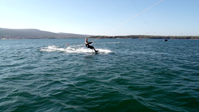 Slow-Mo: Wakeboarder Carving And Jumping In Water video