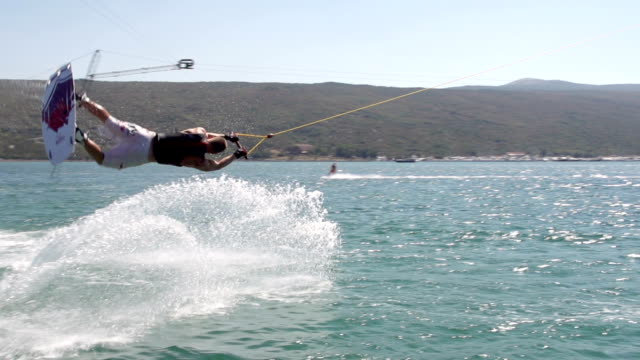 Slow-Mo: Wakeboarder Doing One Handed Flip Trick video