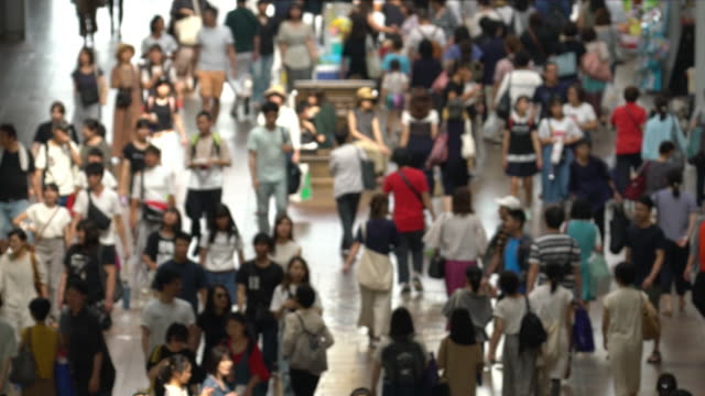 Slowmotion: abstract blurred background top view Tourist pedestrian crowded at Motomachi Shopping street Kobe Japan