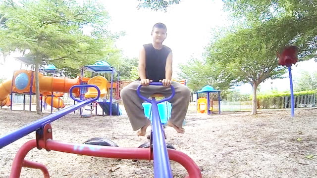 Slow-Motion Boy Playing On A Seesaw video