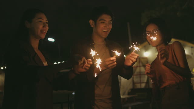 slowmotion friends playing sparkler-stock video video