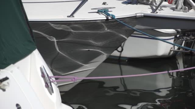 Slowmotion shot of sun glares on board a boat video