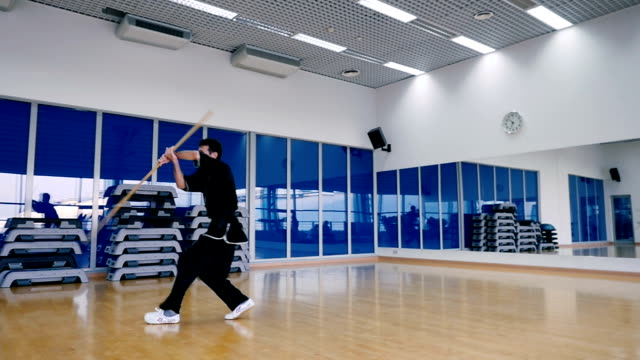 Slowmotion: skillful man attacks the invisible opponent in the air in the gym video