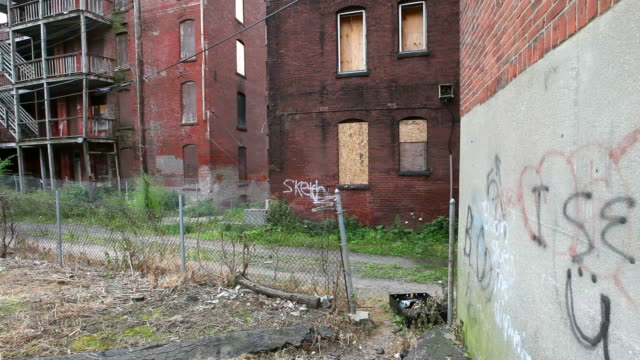Slum Poor blighted abandoned inner city neighborhood in Holyoke, Massachusetts poverty stock videos & royalty-free footage