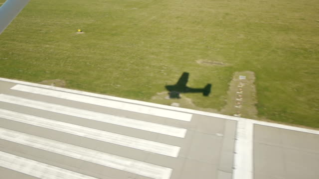 small airplane landing shadow small airplane landing shadow aerial view airfield stock videos & royalty-free footage