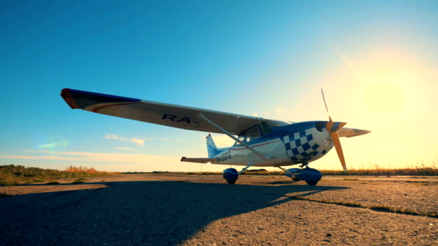 A small airplane on a runway, close up. White airplane on a runway. propeller airplane stock videos & royalty-free footage