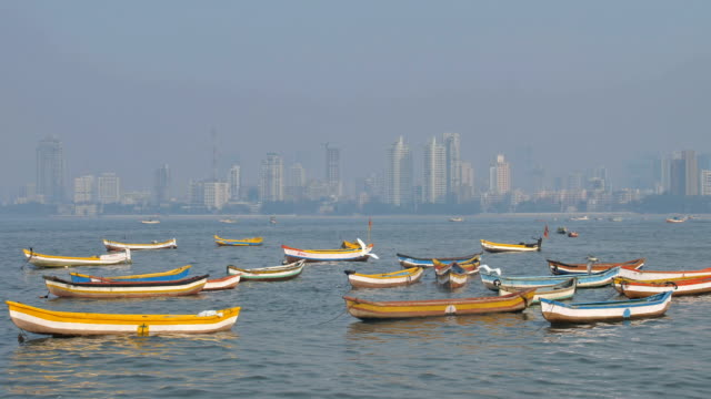 Small and colorful fishing boats are parked in the Arabian sea video