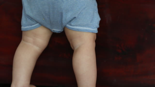 Small baby feet and toes tiptoeing. Child toddler tiptoes closeup