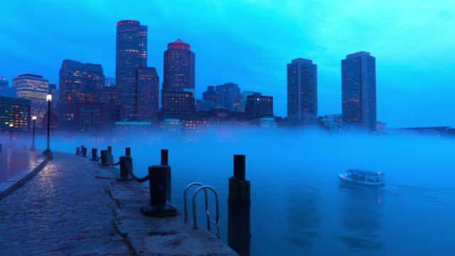 Small boat entering a foggy Boston Harbor. video
