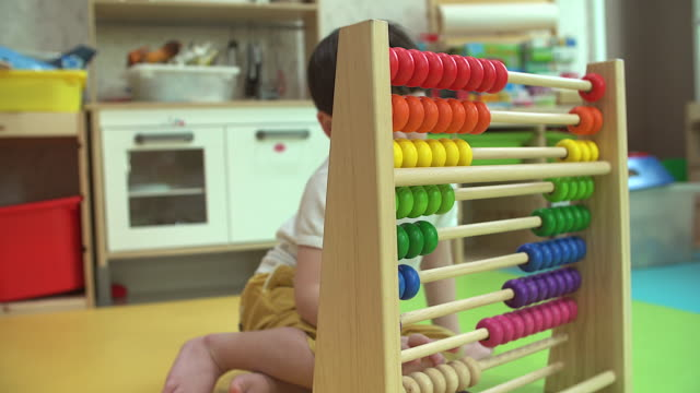 small boy counting with abacus indoor. - banchi scuola video stock e b–roll