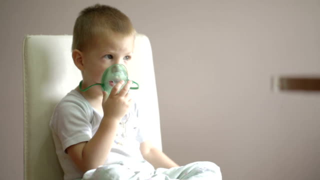 small boy inhaling video