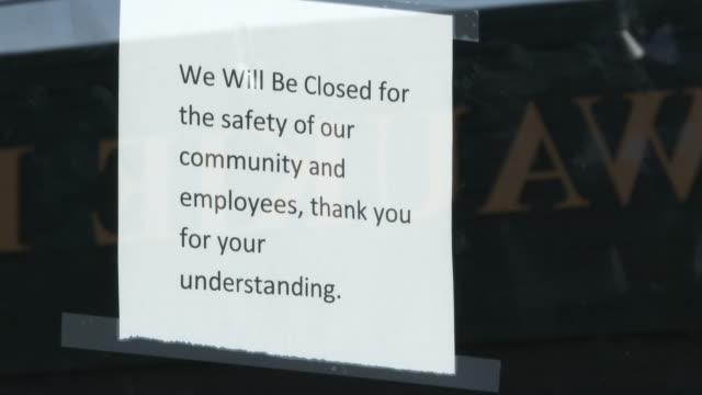 small business closed for safety of community and employees - rack focus video stock e b–roll