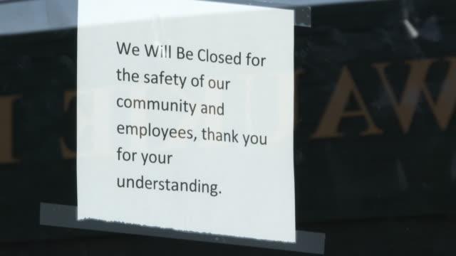 지역사회 와 직원의 안전을 위해 중소기업 폐쇄 - 초점 이동 스톡 비디오 및 b-롤 화면