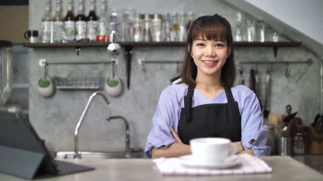 Small business owner in cake and coffee shop, Slow motion video