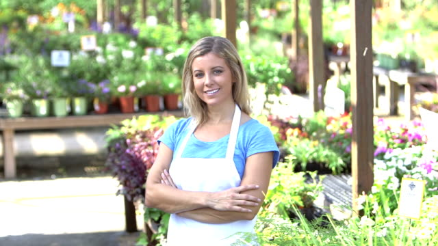 Small business owner - woman in garden center - video