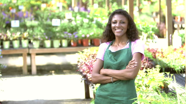 Small business owner - woman in garden center video