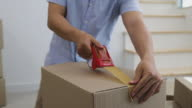istock Small business, Selling Online, Online marketing and SME entrepreneur. A man who are online merchants packing products into carton box by tape for delivery by post for customer orders. 1197488537