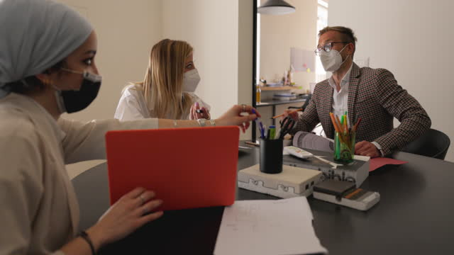 Small business team at work in the office video
