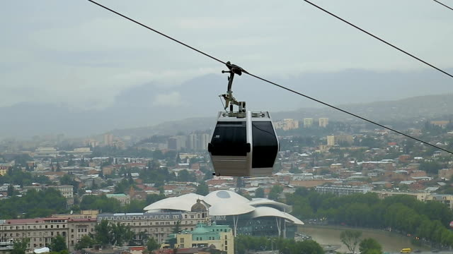 Small cable car running along cableroad transporting tourists and city residents video