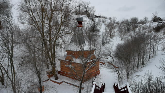 small church church stolit in the mountains solitude Christianity religion winter landscape video