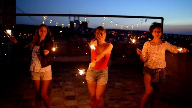 small female rooftop party - pantaloncini video stock e b–roll