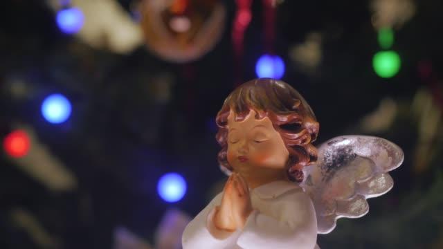 small figurine of an angel - angelo video stock e b–roll