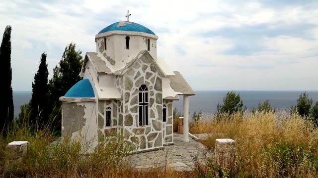 Small Greek temple on the hill near Aegean Sea video