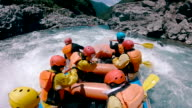 istock Small group of men and women white water river rafting 985549906