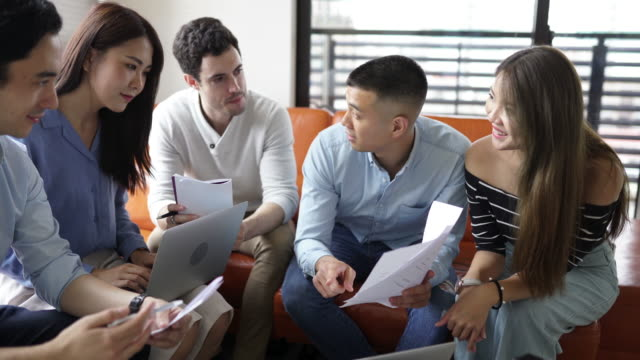 Small group of millennials working together in the apartment video