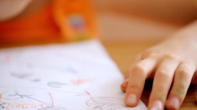 Small hands draw picture with marker video