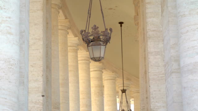A small hanging lamp inside the temple in Vatican Rome Italy A small hanging lamp inside the temple in Vatican Rome Italy, found inside the Basilica of Saint Peter architectural column stock videos & royalty-free footage