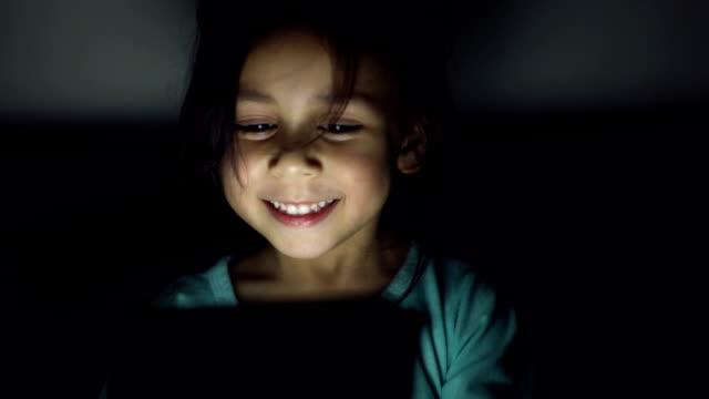 small happy child with tablet. - развлекательные игры стоковые видео и кадры b-roll