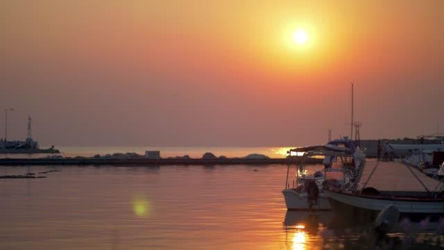 Small harbour quiet scene at sunset