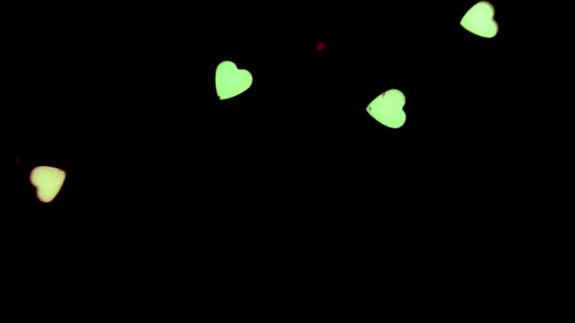 Small hearts on a black background