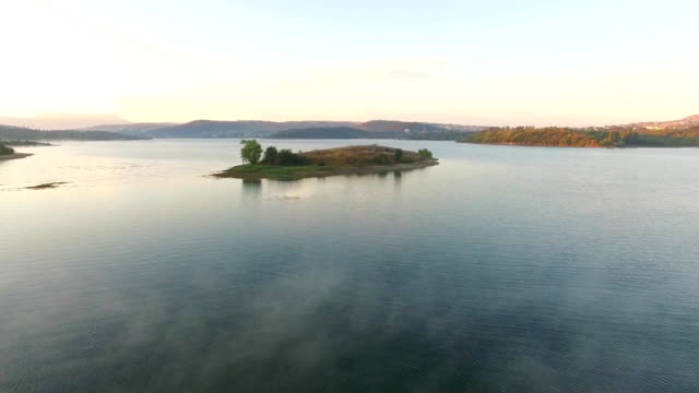 aerial view. small island in the middle of water reservoir - paesaggio marino video stock e b–roll